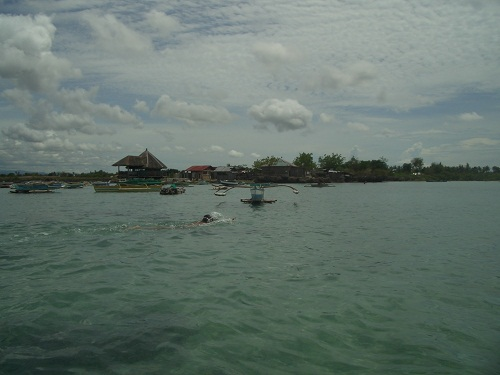 Swimming in front of Kamampay beach resort, Buagsong, Cordova